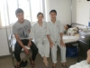 Patient Ho Thi Canh Mung with her family at the hospital
